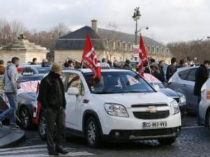 Paris taxi drivers protest against Uber in January  AFP/François Guillot