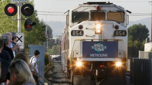 FILE - In this Sept. 15, 2008 file photo, commuters wait at the Chatsworth Metrolink train station in Chatsworth, Calif. The once-booming regional rail service Metrolink has been shedding riders in big numbers. Metrolink has seen a drop of nearly 600,000 annual passengers since its 2008 peak. (AP Photo/Damian Dovarganes,File)